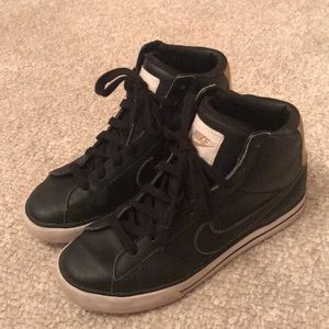 Black and gold high top nike shoes